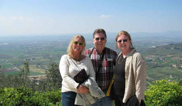 Patti Reed (left) with Jim and Susan McLaughlin